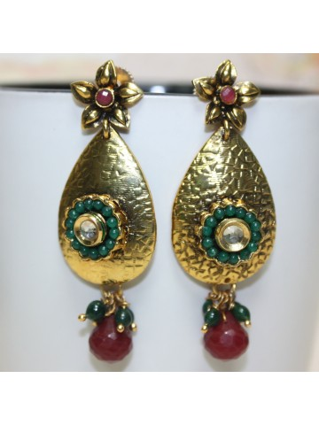 https://static4.cilory.com/16019-thickbox_default/ellegant-polki-work-earrings-carved-with-stone-and-beads.jpg