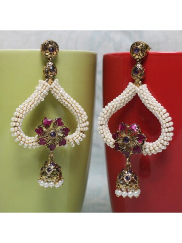 https://static8.cilory.com/22231-thickbox_default/elegant-polki-work-earrings-carved-in-stone-and-beads.jpg