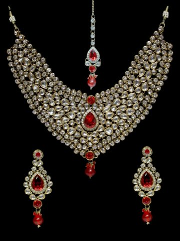 https://static.cilory.com/313593-thickbox_default/ethnic-kundan-work-necklace-set-carved-with-stone-and-beads.jpg