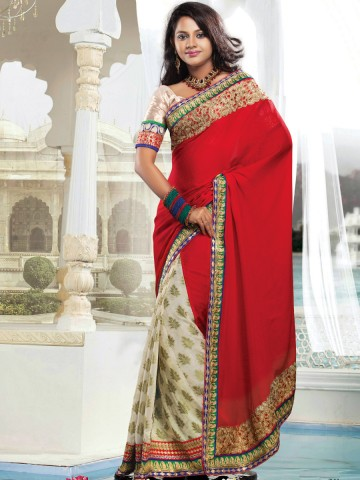 https://static8.cilory.com/55445-thickbox_default/touch-trendz-designer-saree.jpg